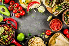 Mexican food concept. Cinco de Mayo food. Cinco de Mayo food.Mexican food concept background with taco, quesadilla, burrito, chili, salsa sauce, hot pepper, lime royalty free stock photography