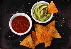 Mexican food concept – Doritos, guacamole and salsa Stock Photos