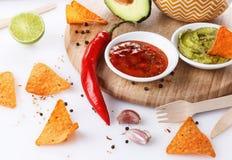 Mexican food concept – Doritos, guacamole and salsa Royalty Free Stock Photo