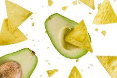 Mexican food concept, guacamole and nachos snack, avocado and to. Rtilla chips on white background, isolate, simple pattern royalty free stock images
