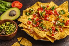 Mexican food concept. Nachos - yellow corn totopos chips with va