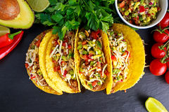 Mexican food - delicious taco shells with ground beef and home made salsa.  stock photography