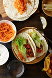 Mexican food - delicious Tacos with ground meat and vegetables Stock Photos