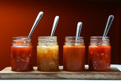 Mexican food dips and sauces in bottles. Photo of different Mexican food dips and sauces in bottles royalty free stock photos