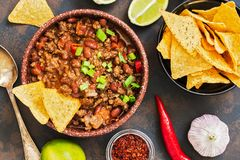 Mexican food dish chili con carne. The concept of Mexican cuisine. Top view, old, rusty background. stock image