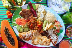 Mexican food dish chili sauces papaya tequila Stock Photo