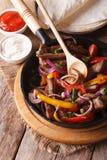 Mexican food: Fajitas close up vertical top view. Mexican food: Fajitas close up vertical view from above Royalty Free Stock Photos