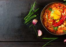 Mexican food - huevos rancheros. Eggs poached in tomato sauce Stock Images