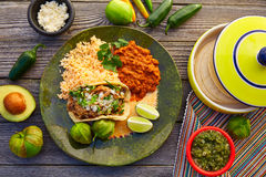 Mexican; food; mexico; kitchen; international; dinner; meal; gourmet; salsa; chips; avocado; table; poblano; pepper; spice; plate. Mexican carnitas tacos with stock photo