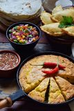 Mexican food mix - tacos, cornbread, salsa with tomato, red onion, lime, cilantro, corn and hot pepper sauce, empanadas. Copy spac. E Royalty Free Stock Photography