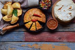 Mexican food mix - tacos, cornbread, salsa with tomato, red onion, lime, cilantro, corn and hot pepper sauce, empanadas. Copy spac. E Stock Image