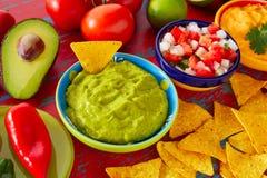 Mexican food nachos guacamole pico gallo cheese Stock Photo