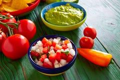 Mexican food nachos guacamole pico gallo chili Stock Images