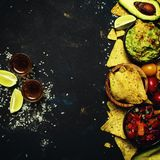 Mexican Food, Nachos, Guacamole, Salsa Sauce and Tequila, Food B. Ackground, Top View stock photography