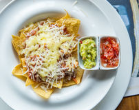 Mexican food nachos with sauce and cheese Royalty Free Stock Photography