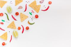 Mexican Food preparation cooking concept. Creative Top view flat lay of fresh mexican food ingredients with tortilla nachos chips garlic pepper lime tomatoes on stock image