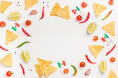 Mexican Food preparation cooking concept. Creative Top view flat lay of fresh mexican food ingredients with tortilla nachos chips garlic pepper lime tomatoes on royalty free stock images