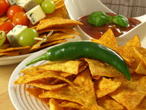 Mexican food for a starter. Mexican nachos for a starter with salsa dip Royalty Free Stock Image