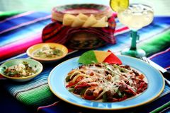Mexican food 2. A mexican steak fajitas platter Royalty Free Stock Photography