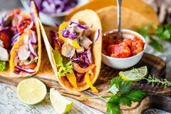 Mexican food tacos, fried chicken, greens, mango, avocado, pepper, salsa. Mexican food tacos, fried chicken, salsaя. greens, mango, avocado, pepper, red cabbage Royalty Free Stock Images