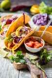 Mexican food tacos, fried chicken, greens, mango, avocado, pepper, salsa. Mexican food tacos, fried chicken, salsaя. greens, mango, avocado, pepper, red cabbage Stock Images