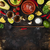 Mexican food and tequila shots Stock Images