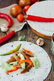 Mexican food - tortilla with traditional vegetarian fajitas on it. Mexican food - tortilla with traditional vegetarian fajitas on it Stock Images