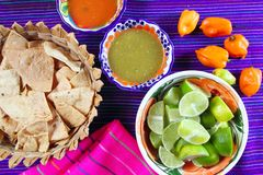 Mexican food varied chili sauces nachos lemon Royalty Free Stock Image