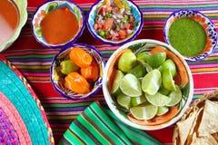 Mexican food varied chili sauces nachos lemon Royalty Free Stock Photos