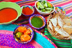 Mexican food varied chili sauces nachos lemon stock photos
