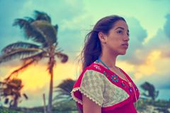 Mexican girl embrodery dress at sunset. In Caribbean palm trees Royalty Free Stock Photo