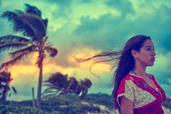 Mexican girl embrodery dress at sunset. In Caribbean palm trees Royalty Free Stock Image
