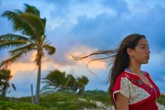 Mexican girl embrodery dress at sunset. In Caribbean palm trees Stock Photo