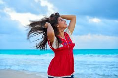 Mexican girl embrodery dress at sunset. In Caribbean sea Stock Photos