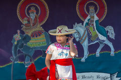 Mexican Girl. A young Mexican girl in traditional costume prepares to dance in a Christmas pageant Royalty Free Stock Images
