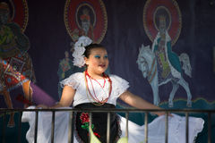 Mexican Girl. A young Mexican girl in traditional costume prepares to dance in a Christmas pageant Stock Photography