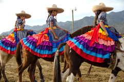 Mexican girls on horseback Royalty Free Stock Photography