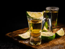 Mexican Gold Tequila with lime and salt on wooden table Stock Images
