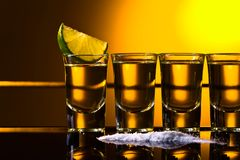 Mexican Gold Tequila in short glasses with lime royalty free stock images