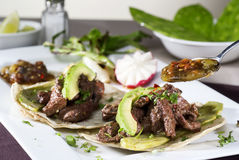 Mexican gourmet accompanied by avocado. Mexican taco gourmet accompanied by avocado Stock Image