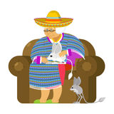 Mexican grandmother and Jerboa a pet. Old woman from Mexico on c. Hair. Sombrero and poncho. Traditional clothes Stock Image