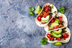 Mexican grilled chicken tacos with avocado, tomato, onion on rustic stone table. Recipe for Cinco de Mayo party. Top view, overhead, flat lay royalty free stock photos