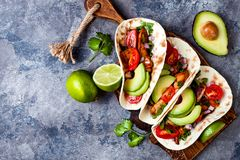 Mexican grilled chicken tacos with avocado, tomato, onion on rustic stone table. Recipe for Cinco de Mayo party. royalty free stock photos