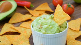 Mexican guacamole with corn chips stock video
