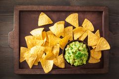 Mexican guacamole dip and nachos tortilla chips royalty free stock photography