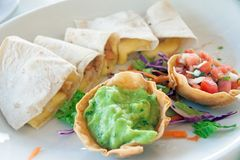 Mexican guacamole with enchiladas. A dish of mexican giuacamole with enchiladas Royalty Free Stock Photo