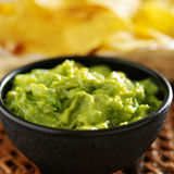 Mexican guacamole in molcajete bowl Stock Photos