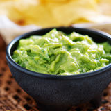 Mexican guacamole in molcajete bowl Royalty Free Stock Images