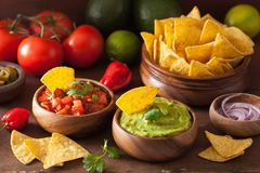 Mexican guacamole and salsa dip, nachos tortilla chips stock images