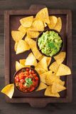 Mexican guacamole and salsa dip, nachos tortilla chips royalty free stock images